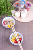 Two dishes of chinese vermicelle and chopsticks Stock Photography