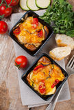 Two dishes of vegetable casserole Stock Images
