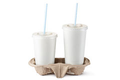 Two disposable cups for beverages in holder. Two disposable cups for beverages in cardboard holder. Standing on a white Royalty Free Stock Images