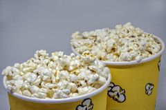 Two disposable paper cups with popcorn Royalty Free Stock Photos