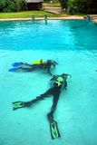 Two divers lie on bottom Royalty Free Stock Images
