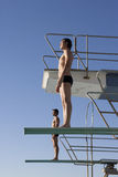 Two divers standing on diving boards Stock Image