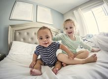Young laughing and playful children playing together at home Royalty Free Stock Image