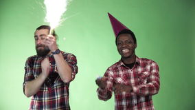 Two diversity man celebrate christmas. Two diversity man celebrate and dancing using cracker pyrotechnics firework and wishing merry christmas stock video footage