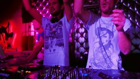 Two DJ and technician working in the night event in the disco bar on the show stock video footage