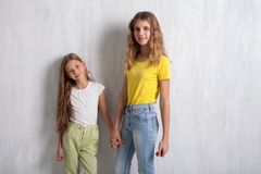 Two girls hold hands fashion portraits healthy eating fruit royalty free stock photography