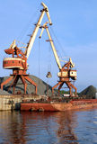 Two dock clamshell. Crane and barge Stock Photos