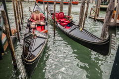 Two docked gondolas Royalty Free Stock Photos