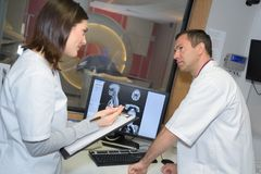 Two doctor examining x-ray film patient stock images