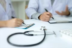 Two doctor talking and consult about healtcare techonlogy Stock Images