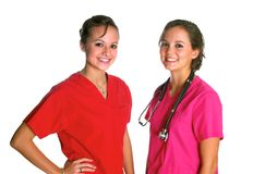 Two Doctors. Two pretty women in surgical scrubs Stock Image