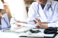 Two doctors being discussing patient history in an office pointi Stock Image