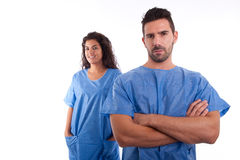 Two doctors in blue hospital uniforms Royalty Free Stock Photos