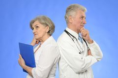 Two doctors on blue Royalty Free Stock Photo