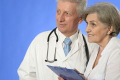 Two doctors on blue Royalty Free Stock Image