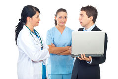 Two doctors and businessman having conversation Royalty Free Stock Images