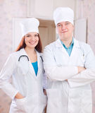 Two doctors in clinic interior Royalty Free Stock Photos