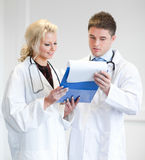 Two doctors with a clipboard Stock Image