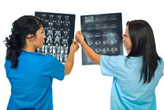 Two doctors compare results of MRI Stock Photos