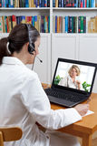 Two doctors computer video call Stock Photos