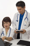 Two Doctors consulting Stock Photo