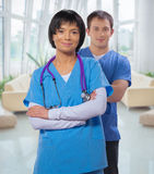 Two doctors with crossed arms Stock Photos