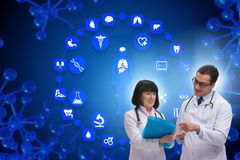 The two doctors discussing issues in telemedicine concept. Two doctors discussing issues in telemedicine concept stock photography