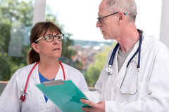 Two doctors discussing about medical report Royalty Free Stock Images