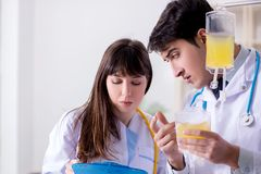 The two doctors discussing plasma and blood transfusion. Two doctors discussing plasma and blood transfusion Royalty Free Stock Images