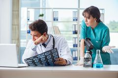 The two doctors discussing x-ray mri image in hospital Stock Photo