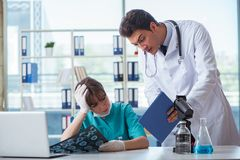 The two doctors discussing x-ray mri image in hospital Stock Images