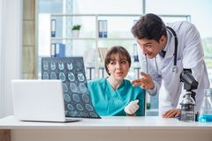 The two doctors discussing x-ray mri image in hospital Royalty Free Stock Photos