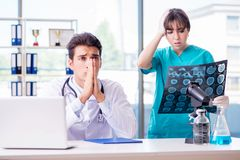 The two doctors discussing x-ray mri image in hospital Royalty Free Stock Image