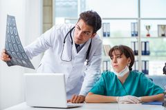 The two doctors discussing x-ray mri image in hospital Stock Image