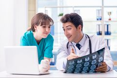 The two doctors discussing x-ray mri image in hospital Stock Photography