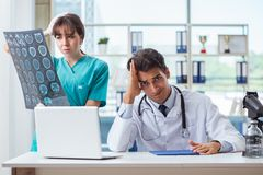 The two doctors discussing x-ray mri image in hospital Royalty Free Stock Photography