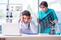The two doctors discussing x-ray mri image in hospital Royalty Free Stock Photo