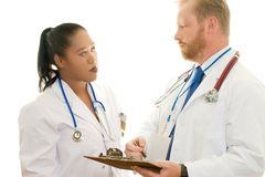 Two doctors in discussion Royalty Free Stock Images