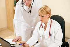Two doctors discussion documents or test results Stock Image