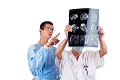 Portrait of two doctors examining a head tomography. Two doctors examining a head tomography stock images