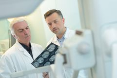 Two doctors examining x-ray Royalty Free Stock Images