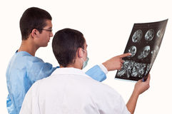 Portrait of two doctors examining a tomography. Two doctors examining a tomography Stock Photo