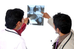 Two Doctors examining the X-ray Royalty Free Stock Photo