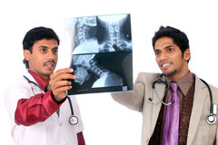 Two Doctors examining the X-ray Royalty Free Stock Images