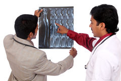 Two Doctors examining the X-ray Royalty Free Stock Photos