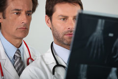 Two doctors examining X-rays Stock Photo