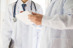 Two doctors in exchange Royalty Free Stock Image