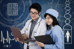 Two doctors and futuristic interface Royalty Free Stock Photo