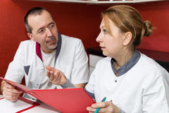 Two doctors having a conversation Royalty Free Stock Images