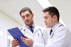 Two doctors at hospital with clipboard Royalty Free Stock Image